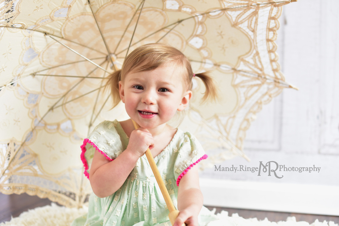 Toddler girl's second birthday portraits // Mint and hot pink, ivory rag rug, vintage lace parasol, two years old // client home - traveling studio // by Mandy Ringe Photography