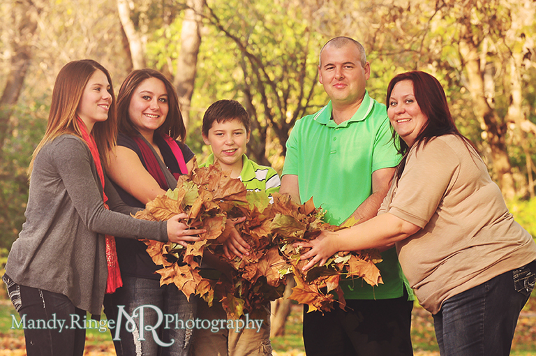 Autumn family portraits - Holding leaves // Fabyan Forest Preserve - Batavia, IL // by Mandy Ringe Photography