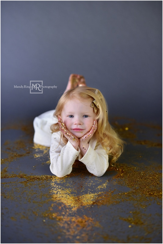 Glitter mini session // Gold glitter, gray backdrop, seamless paper, large and small glitter, ivory dress, gold bow // St. Charles, IL // by Mandy Ringe Photography