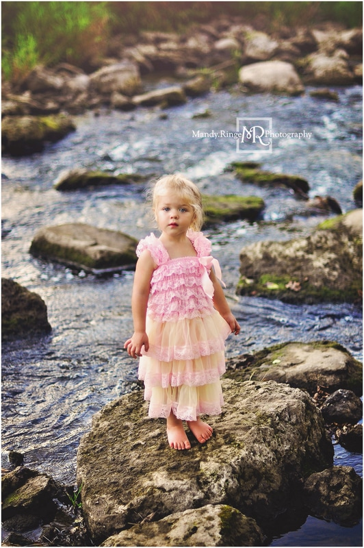2 year old girl // fancy dress, pink and yellow ruffle, creek, goldenhour, summer, rocks // Leroy Oakes Forest Preserve - St. Charles, IL // by Mandy Ringe Photography