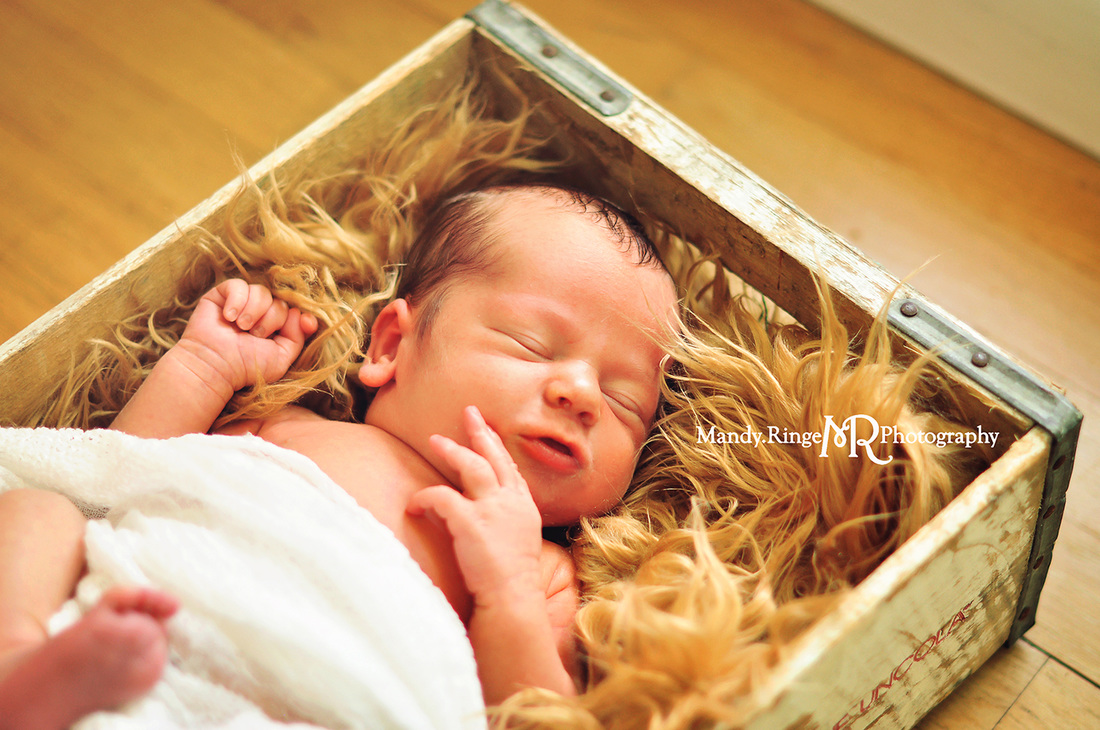 Newborn portraits - first newborn shoot // Loose ivory wrap, caramel fur stuffer, vintage crate // by Mandy Ringe Photography