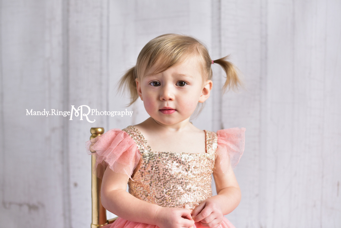 Toddler girl's second birthday portraits // pink and gold angel sleeve dress, gold sequins, two years old // client home - traveling studio // by Mandy Ringe Photography
