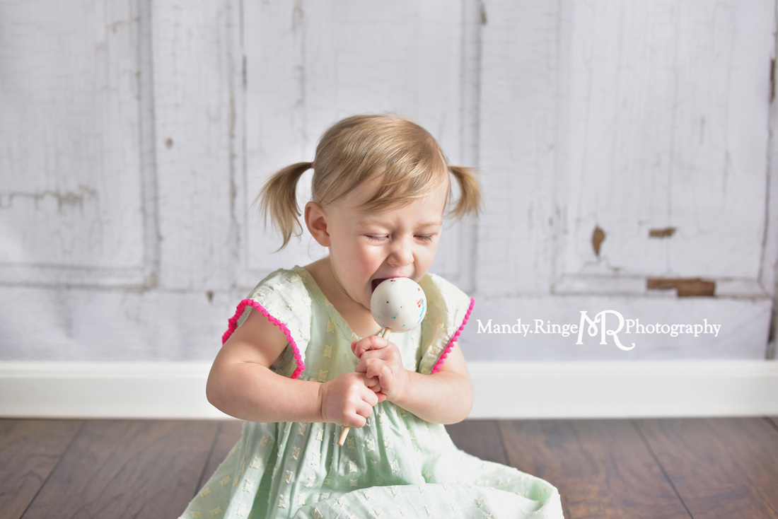 Toddler girl's second birthday portraits // Mint and hot pink, jawbreaker lollipop, sucker, two years old // client home - traveling studio // by Mandy Ringe Photography