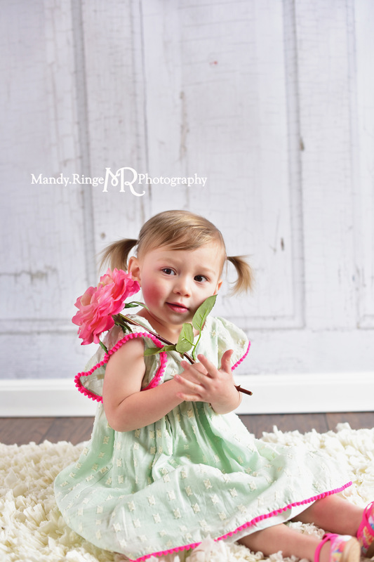 Toddler girl's second birthday portraits // Mint and hot pink, ivory rag rug, pink rose, two years old // client home - traveling studio // by Mandy Ringe Photography
