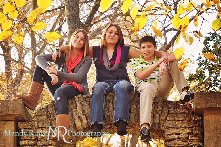 Autumn family portraits - Sitting on a stone arch // Fabyan Forest Preserve - Batavia, IL // by Mandy Ringe Photography