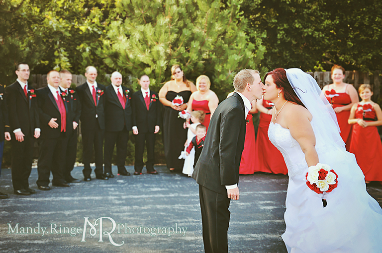 Bride and groom kissing in front of the wedding party - black, white and red wedding // Wedding Photography // Lincoln Inn Banquets - Batavia, IL // by Mandy Ringe Photography