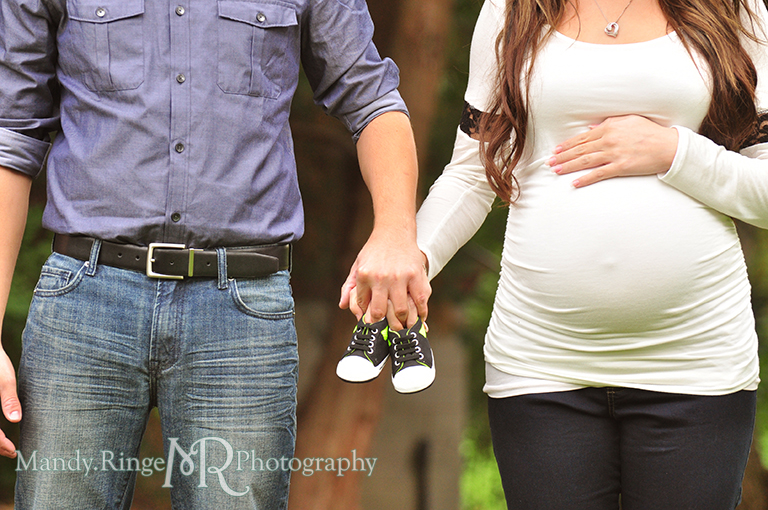 Man and woman holding baby shoes // Maternity portraits // Hurley Gardens - Wheaton, IL // by Mandy Ringe Photography