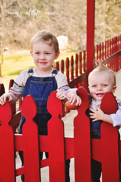 Cousins photo shoot // Boys, red fence, overalls // Camden, OH // by Mandy Ringe Photography