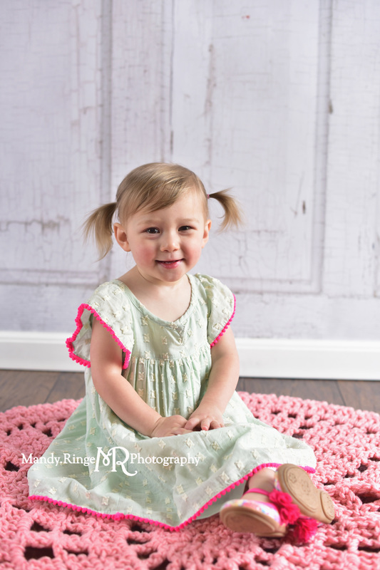 Toddler girl's second birthday portraits // Mint and hot pink, pink crochet afghan, two years old // client home - traveling studio // by Mandy Ringe Photography