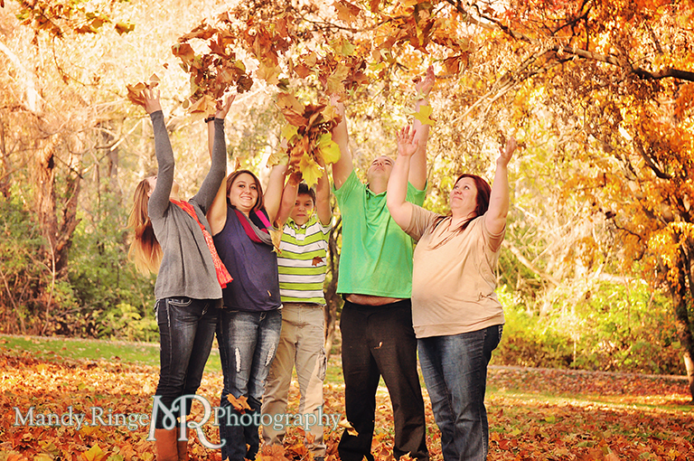 Autumn family portraits - Throwing leaves in the air // Fabyan Forest Preserve - Batavia, IL // by Mandy Ringe Photography