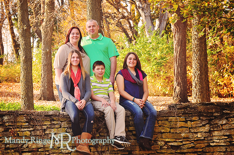 Autumn family portraits - Sitting on a stone wall // Fabyan Forest Preserve - Batavia, IL // by Mandy Ringe Photography