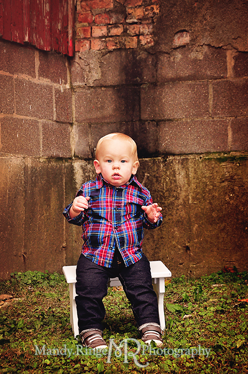 1 year old boy sitting on a small bench in front of a cement brick wall // First birthday portraits // Leroy Oaks - St Charles, IL // by Mandy Ringe Photography