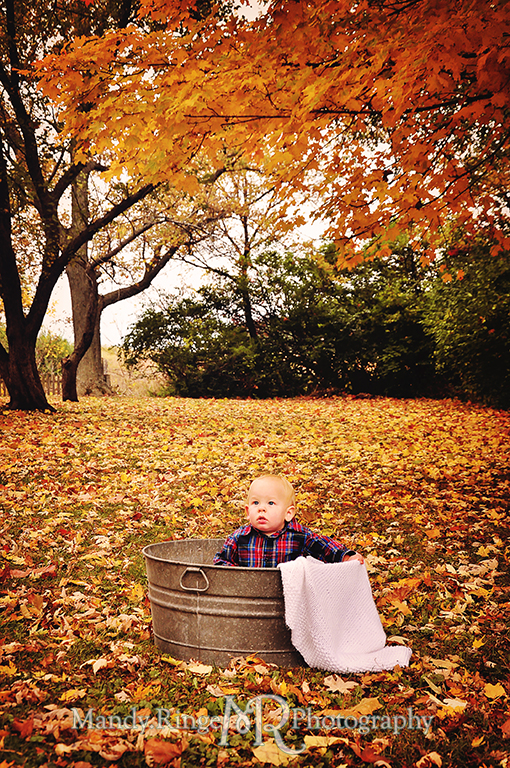 1 year old boy sitting in a wash tub with a blanket surrounded by fallen leaves // First birthday portraits // Leroy Oaks - St Charles, IL // by Mandy Ringe Photography