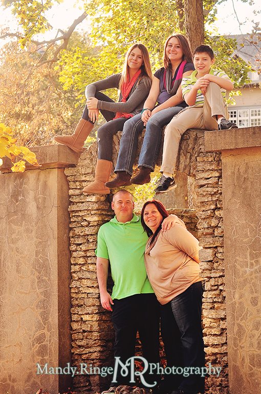 Autumn family portraits - Standing under a stone arch // Fabyan Forest Preserve - Batavia, IL // by Mandy Ringe Photography