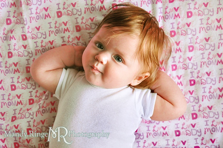 Monthly baby photos // Fabric background, white onesie // by Mandy Ringe Photography