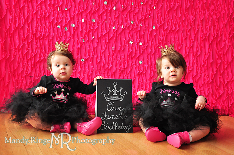 Twin girl's first birthday portraits // Pink and black, tutus, gold lace crowns, pink cowboy boots, pink ruffle backdrop, rhinestones, chalkboard sign // by Mandy Ringe Photography