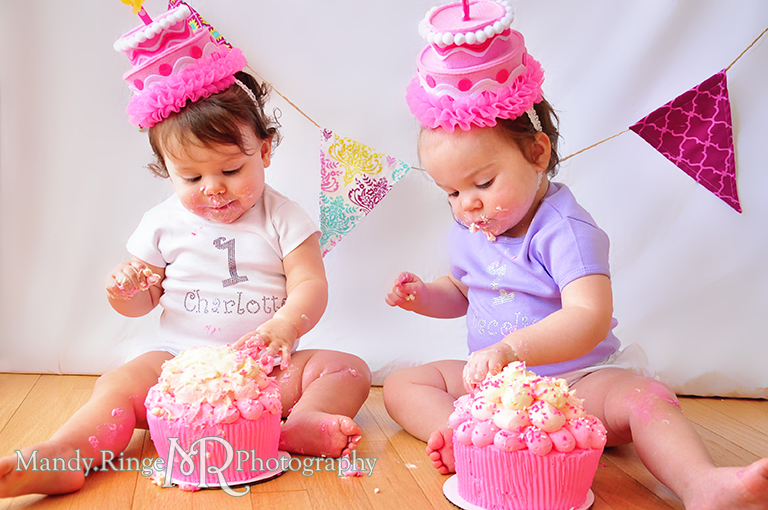 Twin girl's first birthday portraits // Cupcake smash cake, pink cake hats, fabric pennants, pink, teal, fuchsia, yellow, rhinestone name shirts // by Mandy Ringe Photography