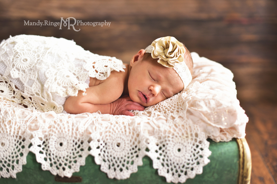 Newborn girl portraits // Dark wood backdrop, floordrop, vintage teal samsonite suitcase, ruffle layer, vintage crochet doily layers, gold flower headband // client's home - Geneva, IL // by Mandy Ringe Photography