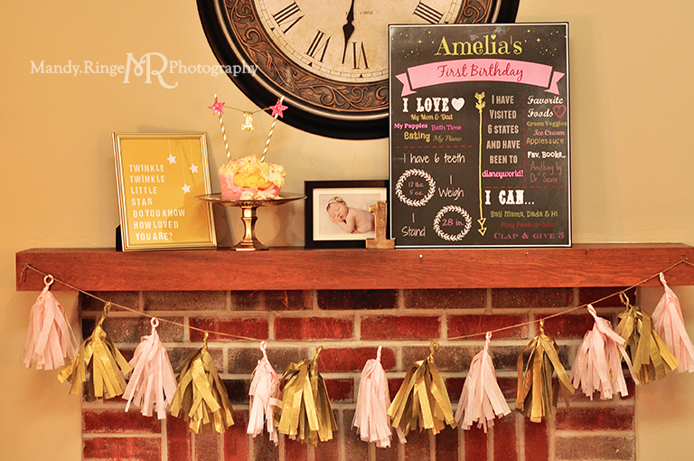 Baby girl's first birthday portraits // Smash cake session // Pink and gold // Birthday party fireplace mantel setup, baby photo, chalkboard infographic, tassle garland, smash cake, number one, Twinkle Twinkle print // by Mandy Ringe Photography