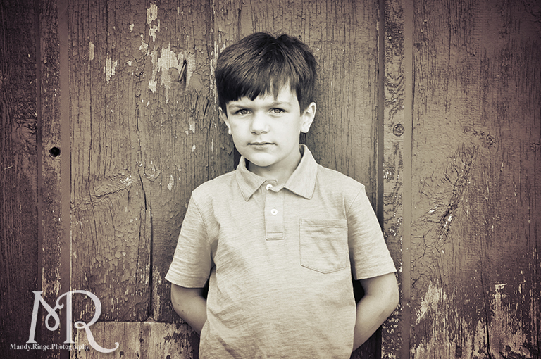 Boy in front of a barn // Leroy Oaks // by Mandy Ringe Photography