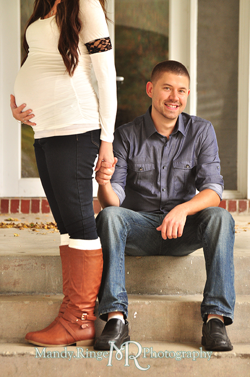 Man and pregnant woman posing on stairs with the focus being on the man holding her hand as she holds her belly // Maternity portraits // Hurley Gardens - Wheaton, IL // by Mandy Ringe Photography