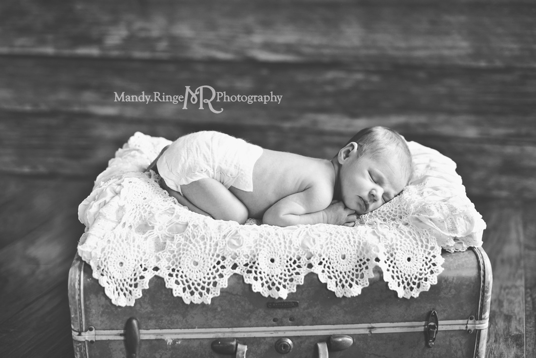 Newborn girl portraits // Dark wood backdrop, floordrop, vintage teal samsonite suitcase, ruffle layer, vintage crochet doily layers // client's home - Geneva, IL // by Mandy Ringe Photography