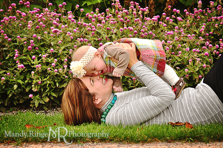 6 month old baby girl portraits // Mom laying down on the grass holding up the baby and snuggling her // Cantigny Gardens - Wheaton, IL // by Mandy Ringe Photography