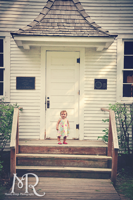 Baby girl standing in front of a one-room schoolhouse // Leroy Oaks // by Mandy Ringe Photography
