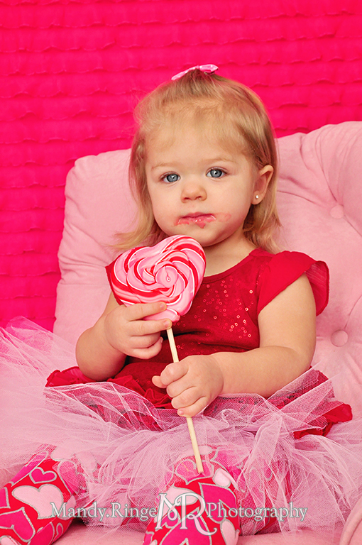 Valentine's Day candy and sweets photoshoot // Pink, fuchsia, red, white // White crate, pink chair, white fur floordrop, pink ruffle backdrop, conversation hearts, cookies, cupcake, cotton candy, lolliopop // by Mandy Ringe Photography