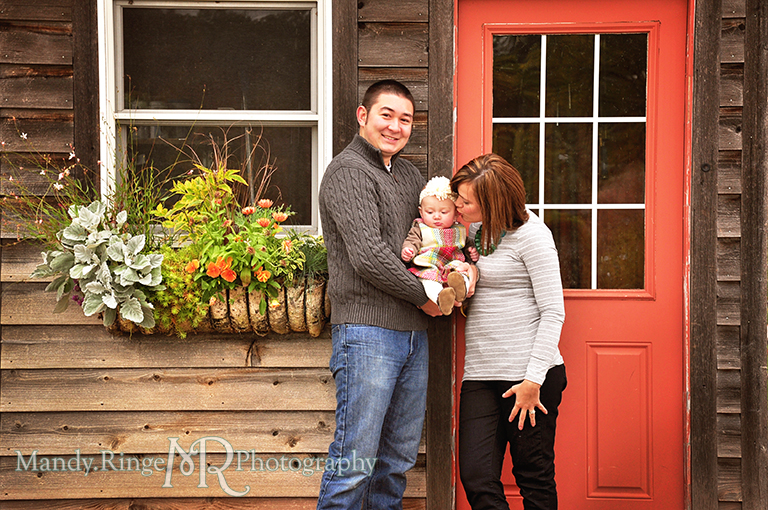 6 month old baby girl portraits // Posing with parents in front of a wooden building with an orange door // Cantigny Gardens - Wheaton, IL // by Mandy Ringe Photography