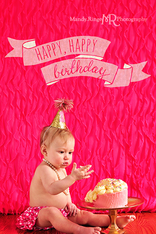 Baby girl's first birthday portraits // Smash cake session // Hot pink and white // Hot pink ruffle backdrop, pink polkadot diaper cover, white pearls // by Mandy Ringe Photography