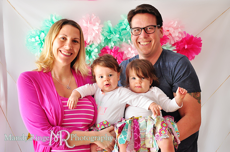 Twin girl's first birthday, family portraits // White chair, fabric pennants, rag banner, rag skirt, pink, teal, fuchsia, yellow, tissue paper pom poms // by Mandy Ringe Photography