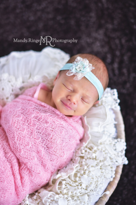 Newborn girl portraits // pink wrap, aqua, teal, mint headband, black rug, round basket, vintage lace stuffer // client's home - Geneva, IL // by Mandy Ringe Photography