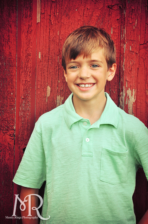 Boy in front of a red barn / / Leroy Oaks // by Mandy Ringe Photography