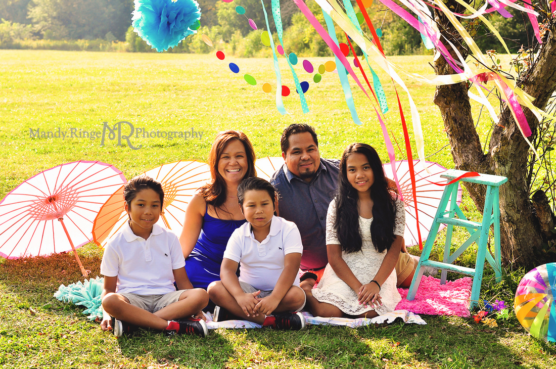 Summer Celebration styled mini session event // colorful, rainbow, paper parasols, rag rugs, beach ball, tissue poms, ribbons, tree, pinwheels // Leroy Oakes Forest Preserve - St. Charles, IL // by Mandy Ringe Photography