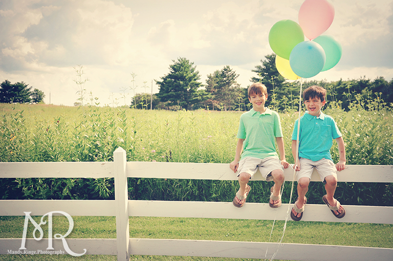 Boys sitting on a white fence with balloons // Leroy Oaks // by Mandy Ringe Photography