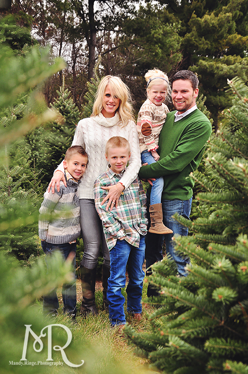 Family Christmas Portrait // Christmas Tree Farm // simple Christmas photo idea, standing among pine trees // by Mandy Ringe Photography