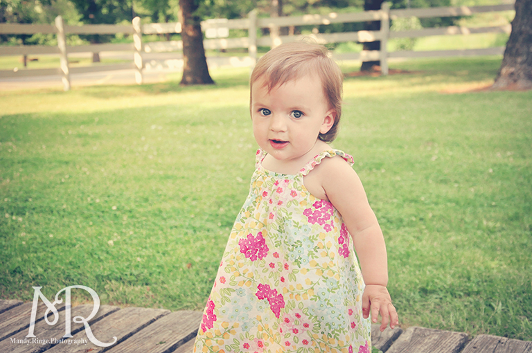Baby girl in front of a white fence // Leroy Oaks // by Mandy Ringe Photography