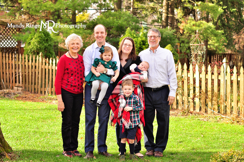 Family Christmas Portraits // Outdoors, plaid blanket, winter // by Mandy Ringe Photography