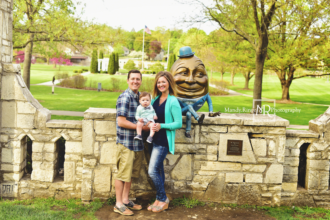 Spring family portraits // family of three, Humpty Dumpty statue, stone wall, teal and navy // Mount St. Mary Park - St. Charles, IL // by Mandy Ringe Photography