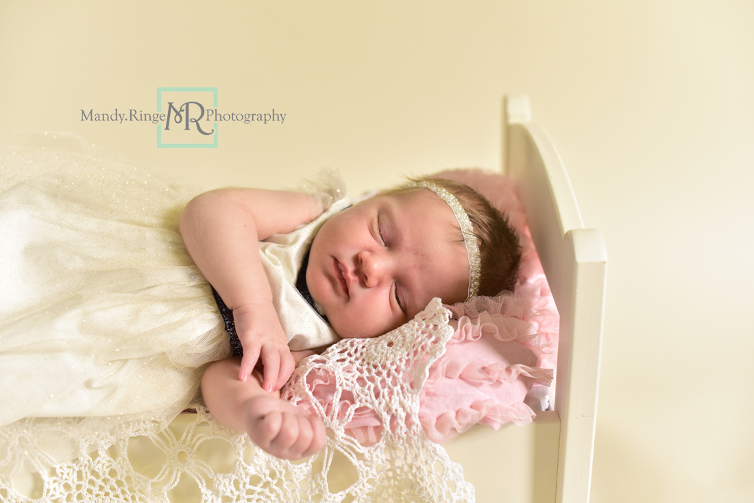 Newborn girl portraits // Sibling portraits, baby bed, vintage doily layer, white fur, matching dresses, ivory and navy // Client's home - St Charles, IL // Mandy Ringe Photography