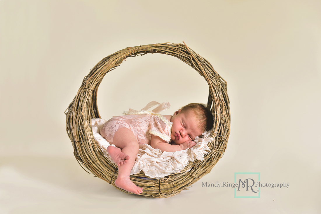 Newborn girl portraits // Round willow basket prop, vertical basket, lace outfit // Client's home - St Charles, IL // Mandy Ringe Photography