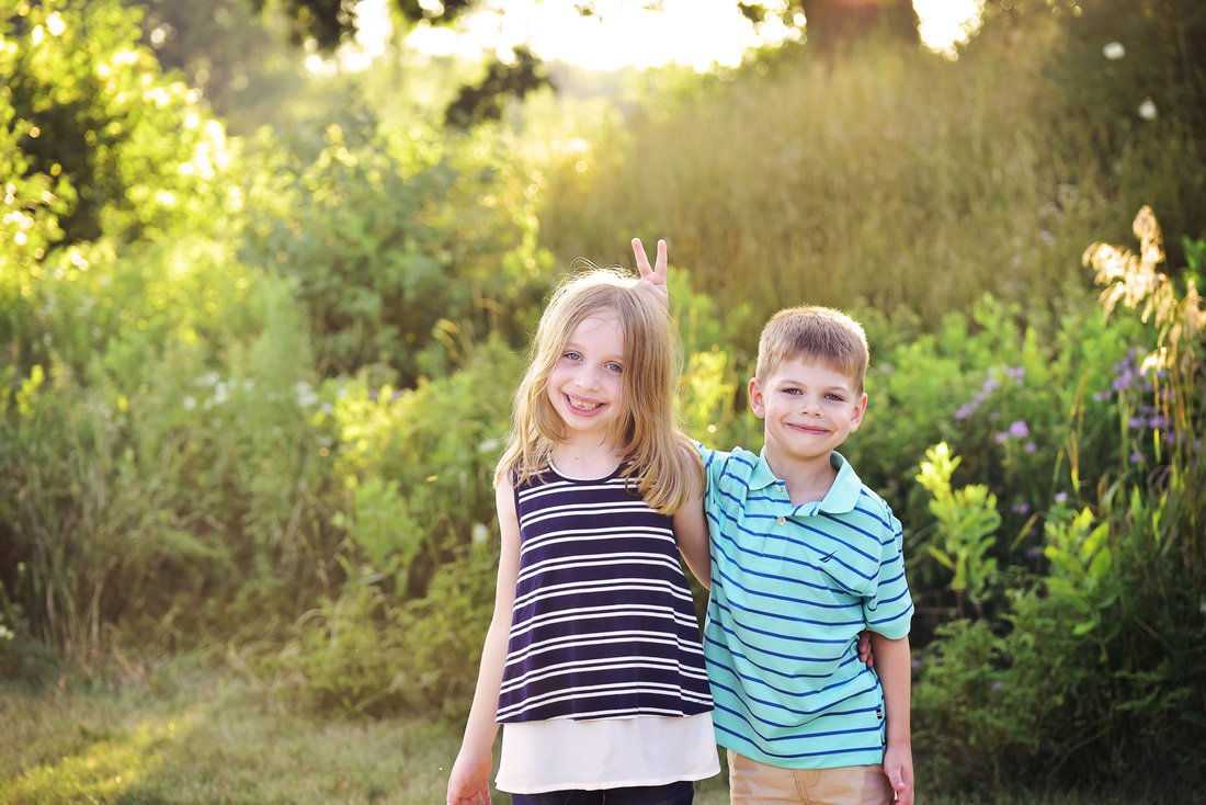 Sibling portraits taken at Fox River Marina in Barrington, IL by Mandy Ringe Photography