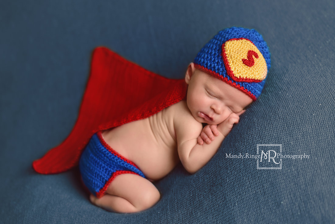 Newborn boy portraits // Crochet Superman outfit, bum up pose, blue blanket // St. Charles, IL studio // by Mandy Ringe Photography