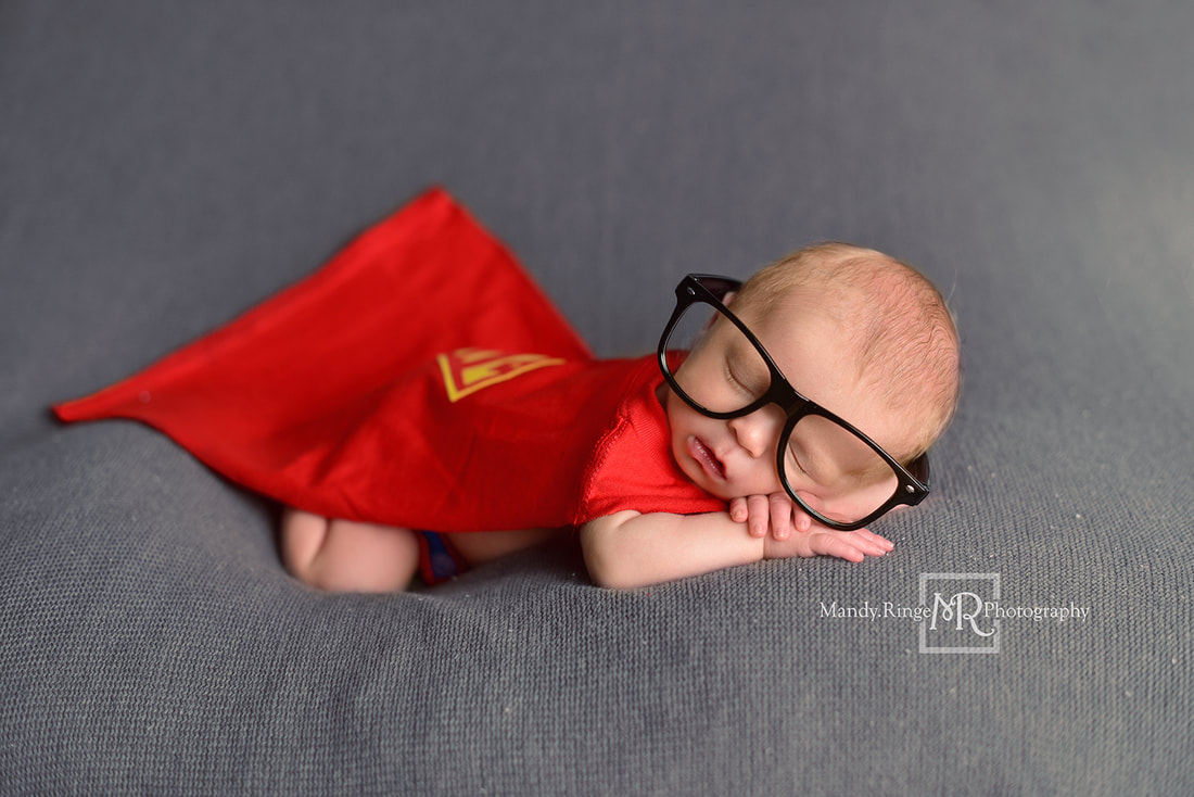 Newborn boy portraits // Superman outfit, cape, Clark Kent glasses, bum up pose, gray blanket // St. Charles, IL studio // by Mandy Ringe Photography